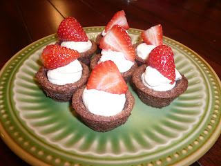 Brownies stuffed with a creamy concoction and a big juicy strawberry on top. These tuxedo brownie cups are elegant and delicious! ohsweetbasil.com
