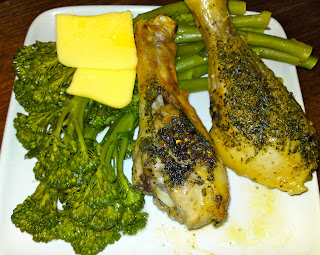Roasted chicken drumsticks and boiled broccolini with butter