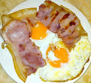 Fried eggs and grilled bacon