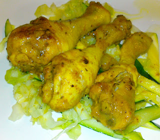 Coconut chicken curry on sautéed cabbage and zucchini