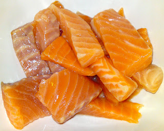 Raw salmon sashimi, chopped and tossed with lemon juice
