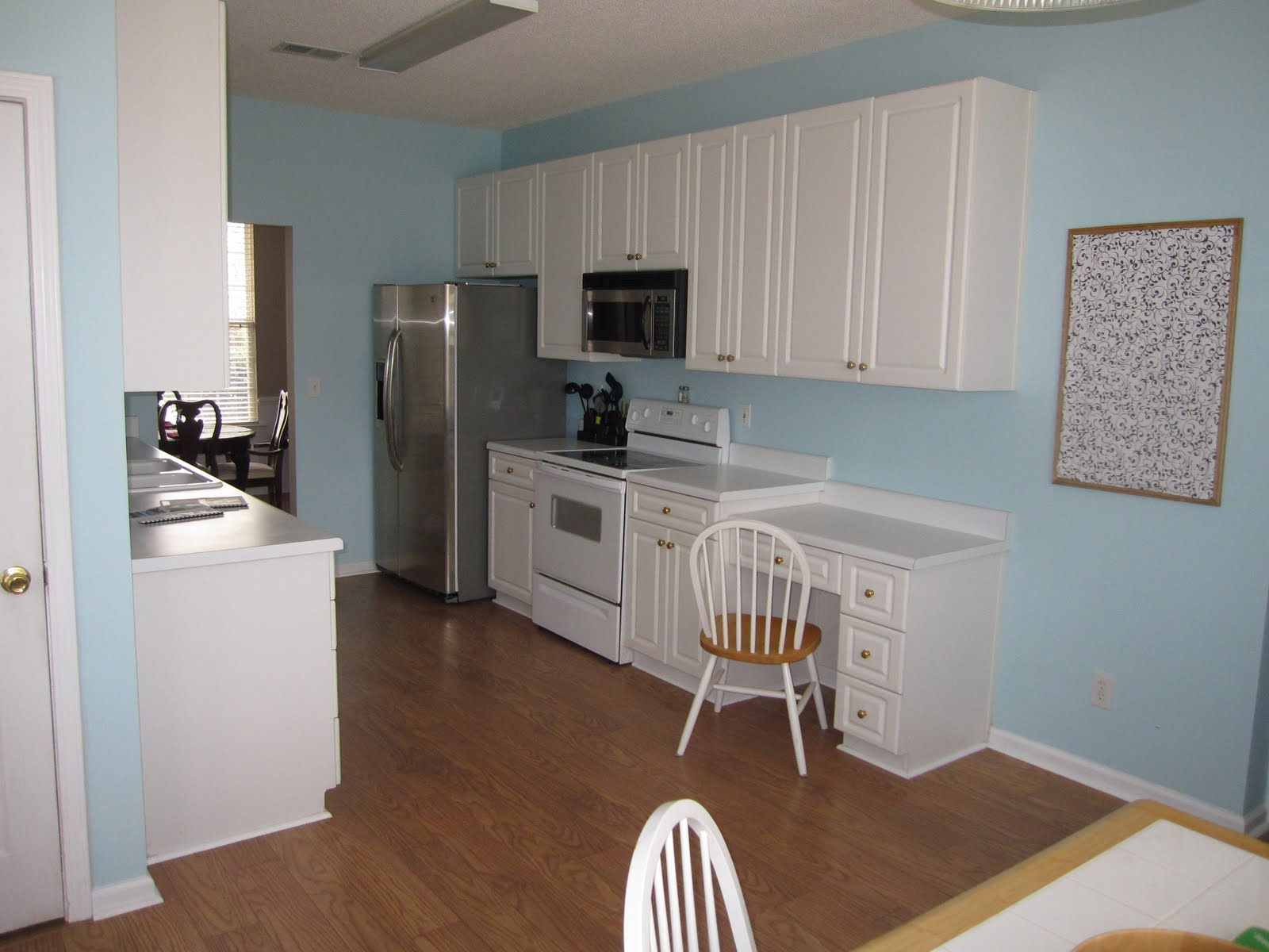Light Blue Kitchen Walls with Brown Cabinets