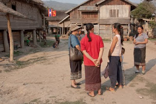 villagers talk with Kommaly Chantavong