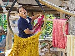Hanging naturally dyed silk yarns to dry, Panmai Group, Northeast Thailand