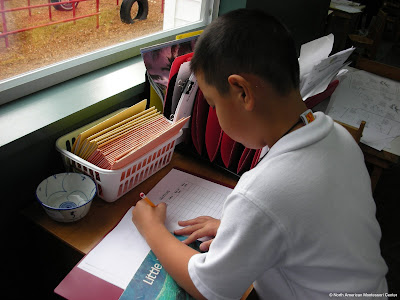countdown to summer NAMC montessori activities boy writes in journal