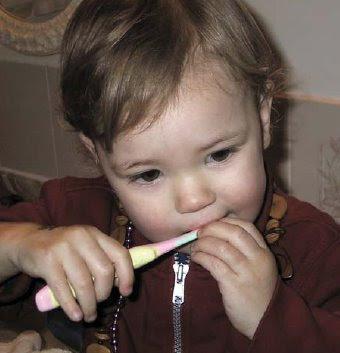 NAMC montessori practical life activities home classroom girl brushing teeth