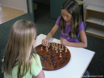 winter enrichment activities for NAMC montessori school girls playing chess