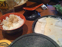 Rice and tortillas on the side