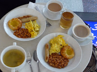 Scrambled eggs, sausage, baked beans, danish, and miso soup at the United Red Carpet Club in Hong Kong.