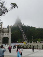 The Tian Tan Buddha, nestled in the clouds.