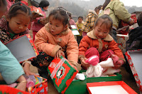 Christmas Child opening gifts