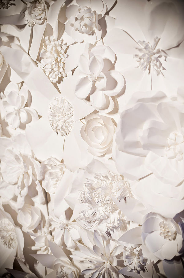 this fabulous paper flower backdrop for a wedding ceremony featured on Style