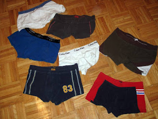 Used men's underwear on a parquet floor.