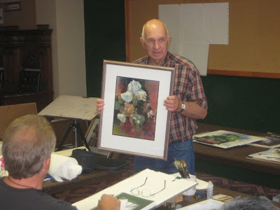 Artist and teacher Osral Allred shows one of his paintings at a workshop sponsored by the Southern Utah Watercolor Society in St. George, UT