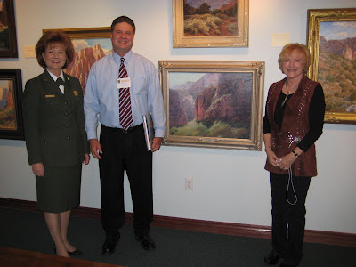 Lyndi Harvey, Roland Lee, and Flavia Eckholm at the Century of Sanctuary Art Exhibit