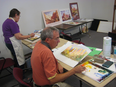 Artists John Mangels and Sandra Feldman working on their watercolor paintings during the Roland Lee watercolor workshop