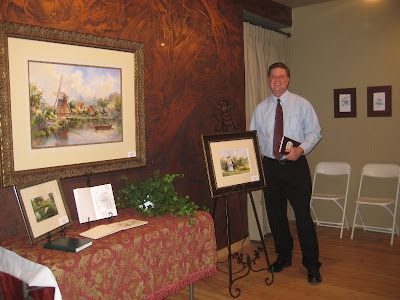 Artist Roland Lee with new paintings of England and Europe at his one man show in Ancestor Square