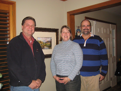 Roland Lee with Jeff and Karianne Prince and their painting Swiss Valley