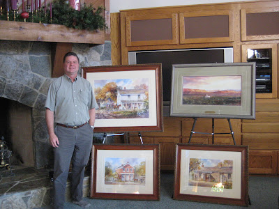 Artist Roland Lee with pioneer paintings of Nauvoo and Kirtland