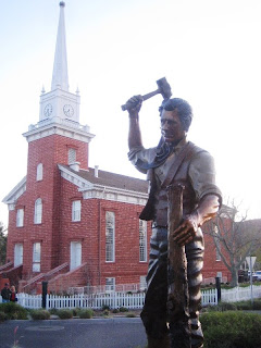 Sculpture by Jerry Anderson of Pioneer Robert Gardner driving the center stake for the city of St. George