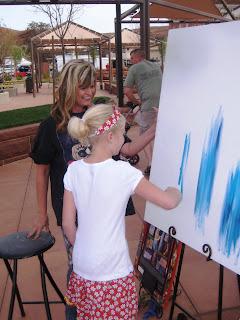 Artist Gina Jrel lets Alyssa help on a painting