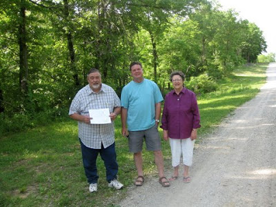Grant Lee, Roland Lee, and Andrea Lee Conley on the Oliver Walker property in Caldwell County Missouri