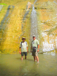 Roland Lee and Jock Whitworth stand by golden wall at Mystery Falls in the Zion Narrows