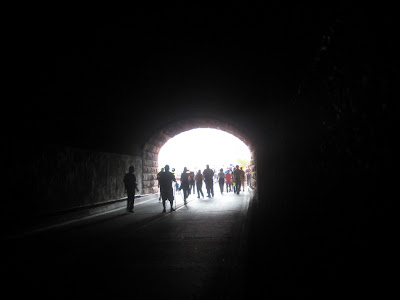 Walkers approach the west end of the Zion Tunnel