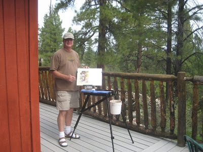Roland Lee painting on the deck of his cabin in East Zion