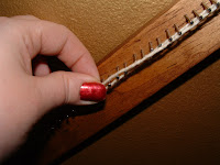 Remove the fringe loop from the nail