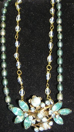 Baby blue and teal pearl with rhinestone brooch centerpiece