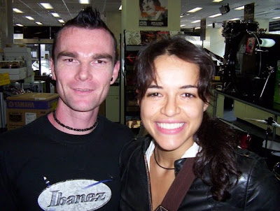 This is Chucky with Michelle Rodriguez, she came into his guitar shop ...