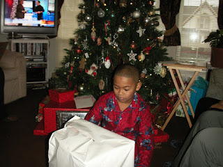 Ethan sizes up the presents