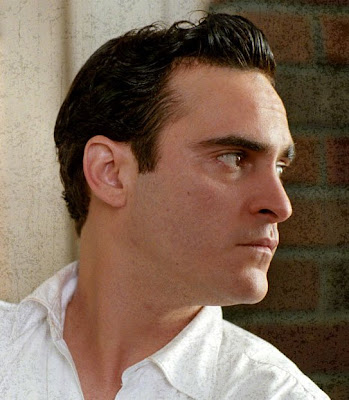 Joaquin Phoenix portraying Johnny Cash