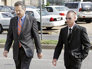 Evangelist (right) and his attorney