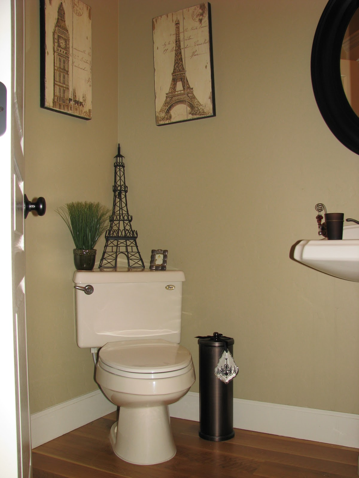 Radiant rooms a simple paris inspired powder room for Paris inspired bathroom ideas