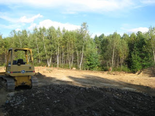 picture of clearing and digging for hose foundation