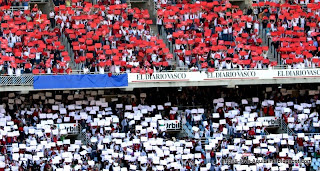 Biarritz supporters show red and white papers, the team colours
