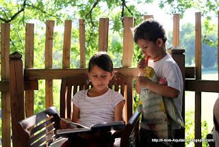 Children reading on the terrace