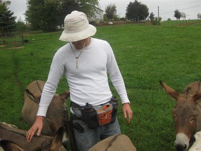 not a fanny pack, petting donkeys on a farm