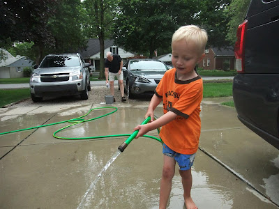 jack watering the driveway, washing cars