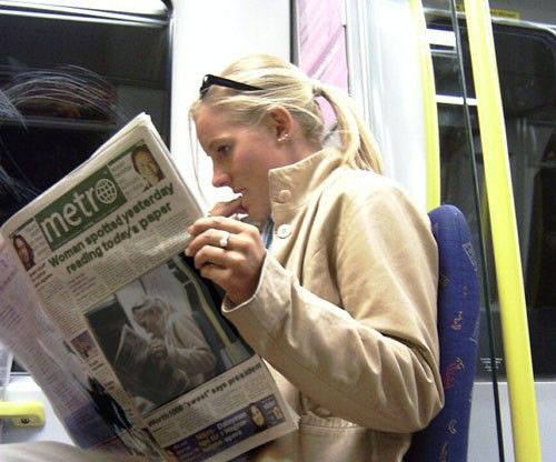 droste, cool, woman reading todays paper on subway, photoshop effect