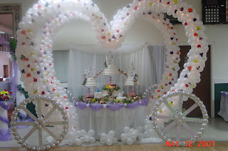fairytale wedding cake surrounded by balloons