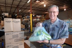 Volunteer Grady Venable shows a personal hygiene kit being created to send to victims of Hurricane Ike.