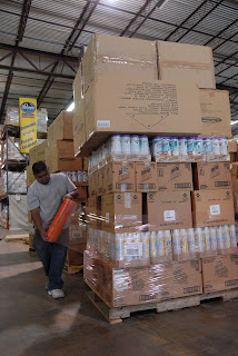 World Vision employee, Pedro Escobar, wraps a pallete of provisions in preparation for transport to victims of Hurricane Ike.
