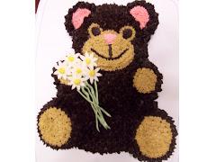 Teddy Bear Holding Dasies