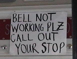 bus sign reading 'bell not working plz call out your stop