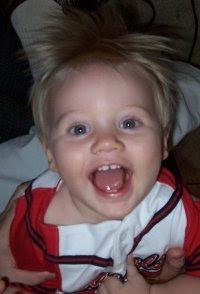 cute toddler hanging upside down, toddler smiling