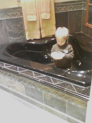 toddler at the tile store
