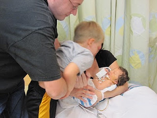 big brother meeting baby brother in NICU